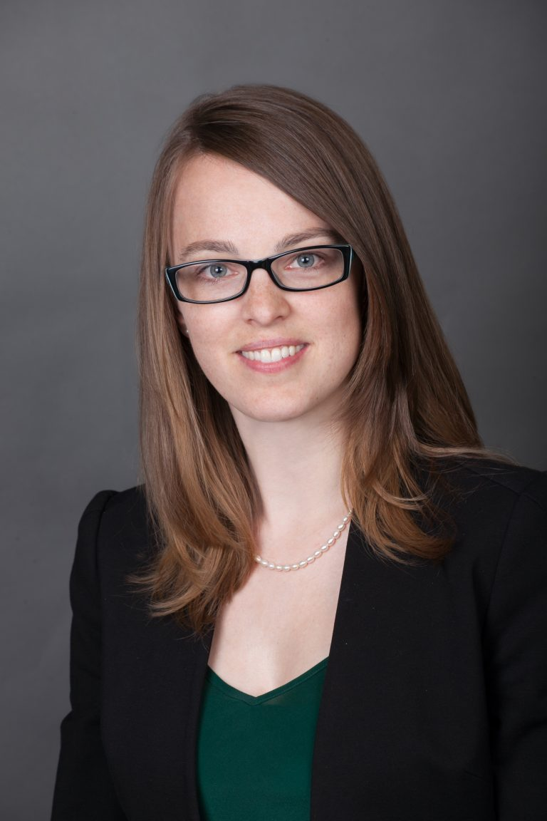 Business headshot of women with glasses
