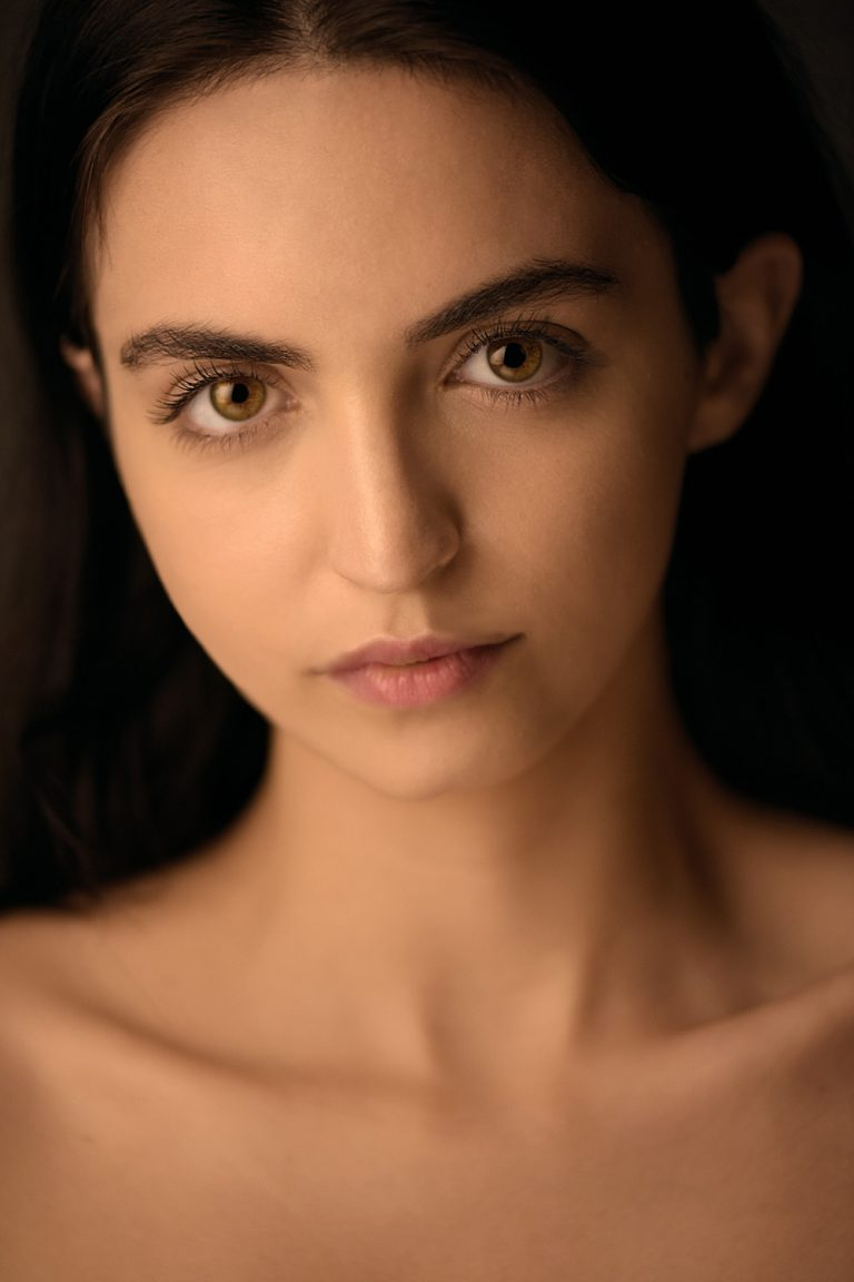 headshot of women with warm light