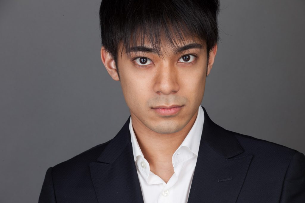headshot of asian man with jacket