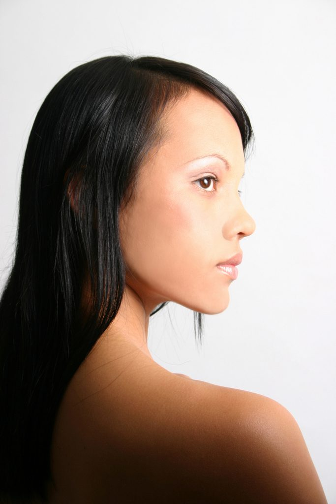 headshot of girl in profile with white background