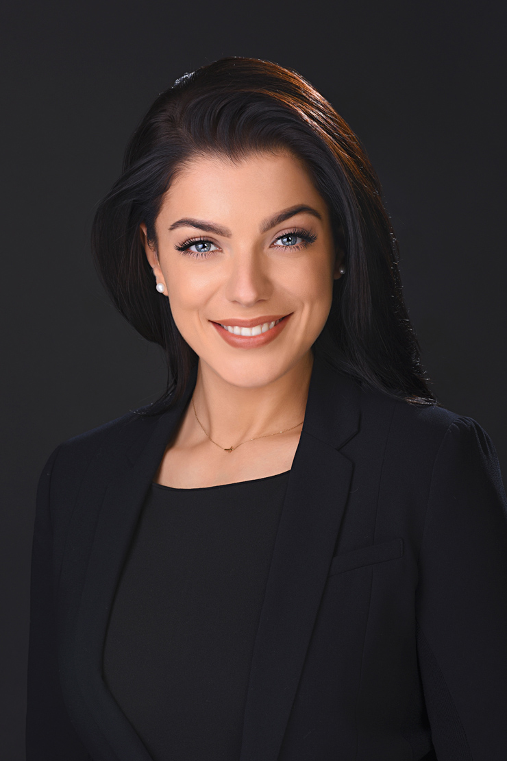 headshot of women with black background