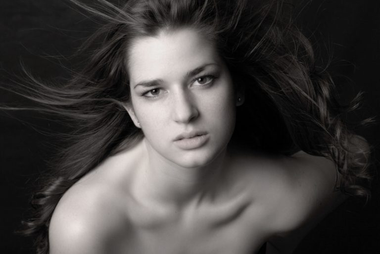 Portrait of women in b+w hair blowing