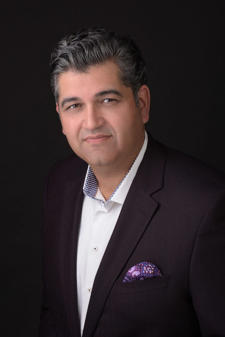 business portrait of man with black background