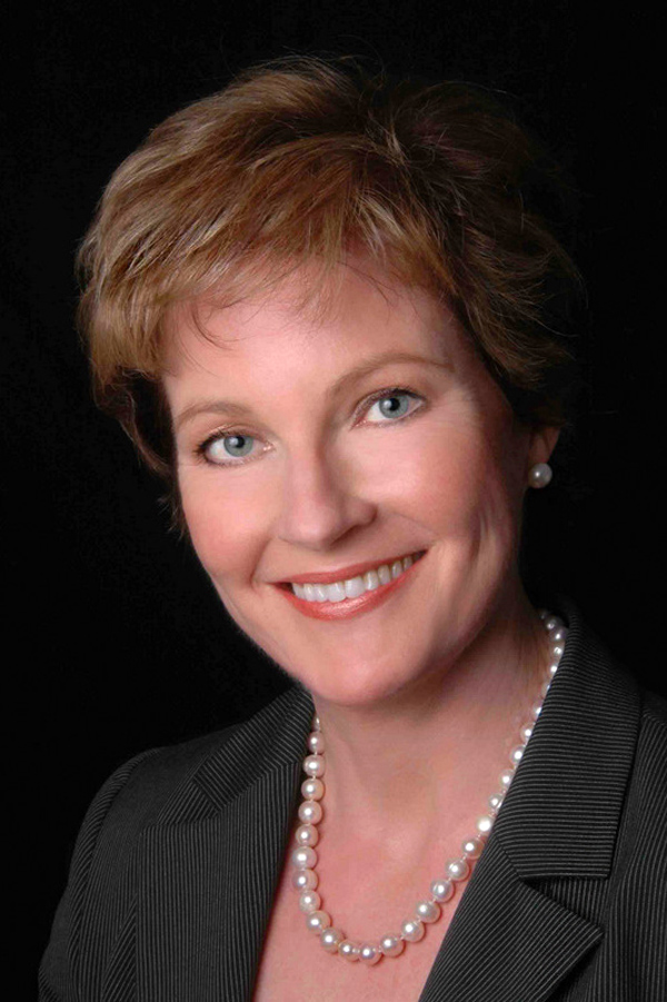 corporate headshot of women with black background
