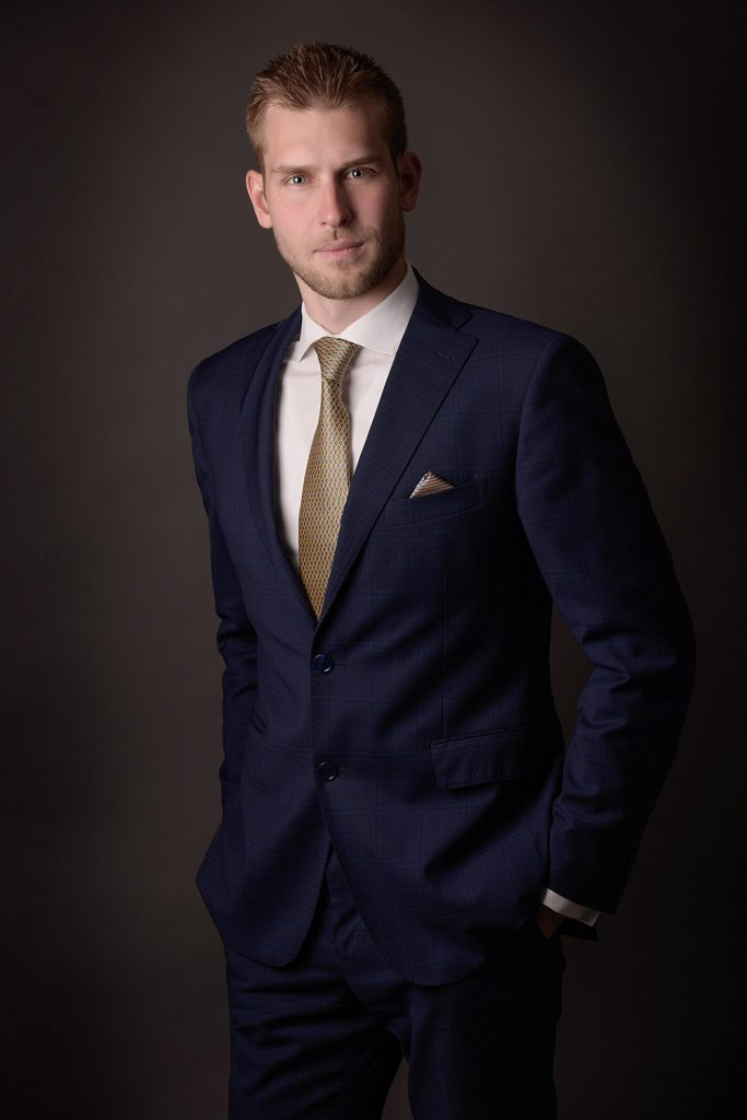 business portrait on man in a suit with darkbackground