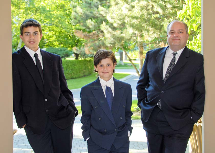 family portrait outside dad with 2 sons