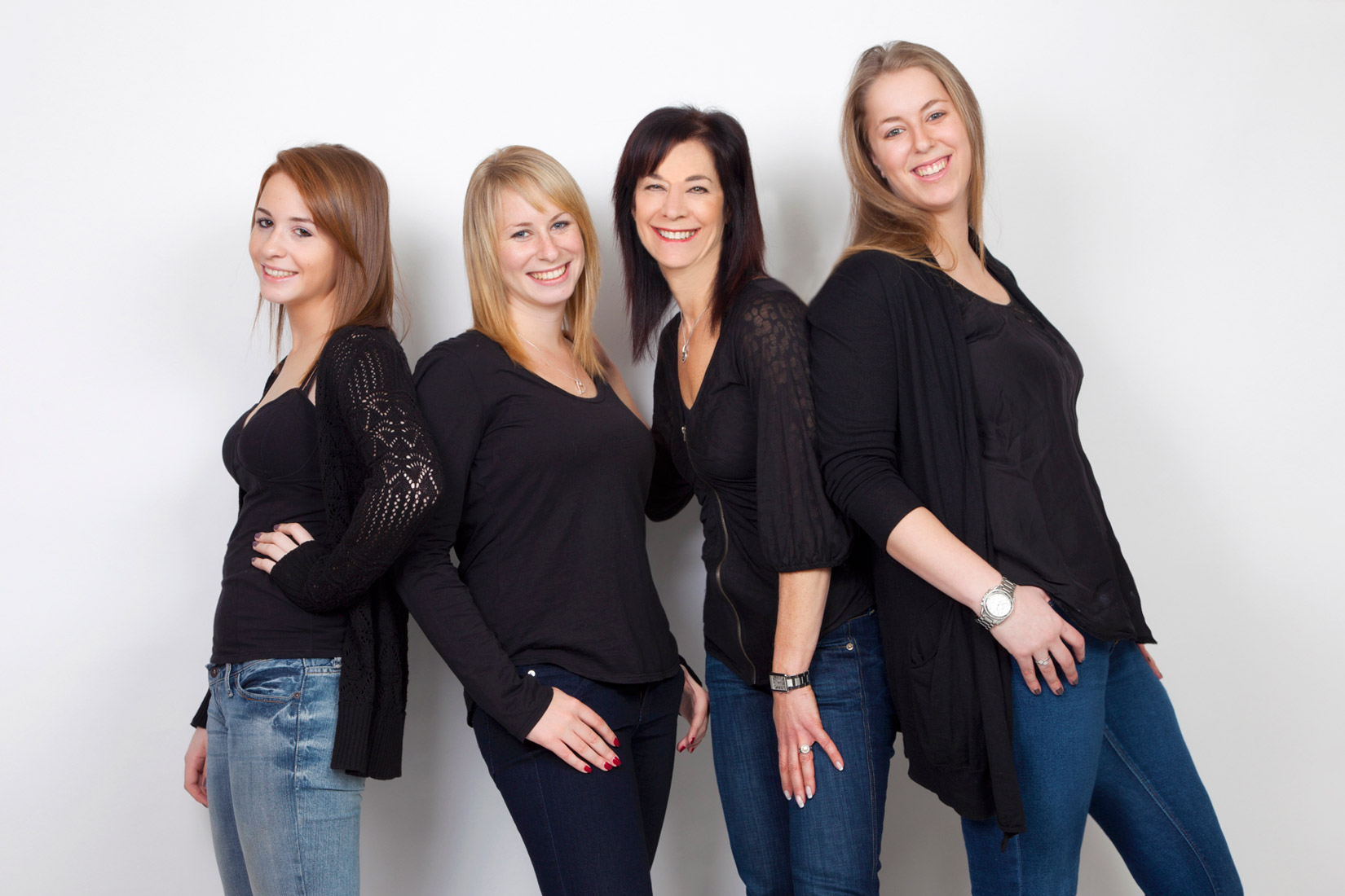 Studio portrait of mom and 3 daughters